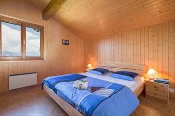 Ein Schlafzimmer im Chalet 4 Vallées